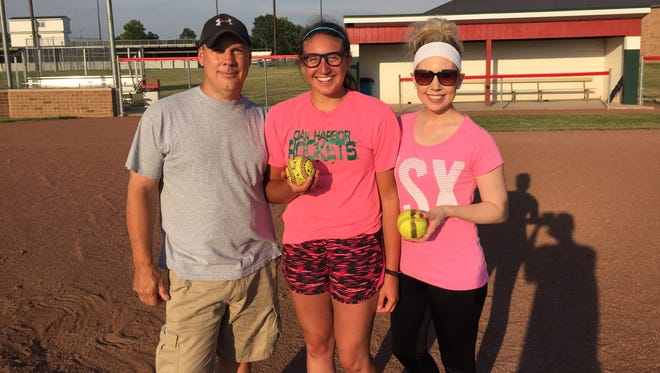 Andy Szypka, left, has trained Oak Harbor's Ashley Riley, center, as a pitcher for several years. Genoa's Shana (Szypka) Scharer, right, also trained with her father and works with Riley.
