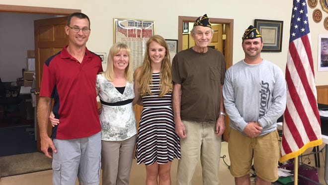 Emily Ziegler was presented the Fond du Lac Area Foundation Trier-Puddy Post No. 75 American Legion Harold C. Berkholtz Scholarship by Cmdr. Mike Matsche. Pictured are, from left: Eugene Ziegler, Jennifer Ziegler, Emily Ziegler, Leonard Ziegler and Cmdr. Mike Matsche.
