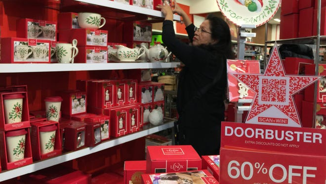 Shoppers can expect to continue to find good discounts in the weeks following Black Friday and Cyber Monday, especially on Super Saturday, the Saturday before Christmas, retail experts say. Here, a woman shops at a Macy's in the Glendale Galleria on Black Friday in Glendale, Calif.
