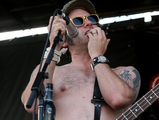"NOFX bassist ""Fat Mike"" Burkett, pictured in 2009 in"