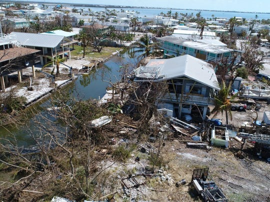 Houses in Cudjoe Key show damage Wednesday, Sept. 13, 2017, days after hurricane Irma ripped through the Florida Keys.