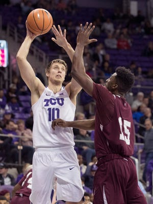 TCU Horned Frogs forward Vladimir Brodziansky (10) shoots over Texas Southern Tigers forward Marquis Salmon (15) during the first half at Ed and Rae Schollmaier Arena.