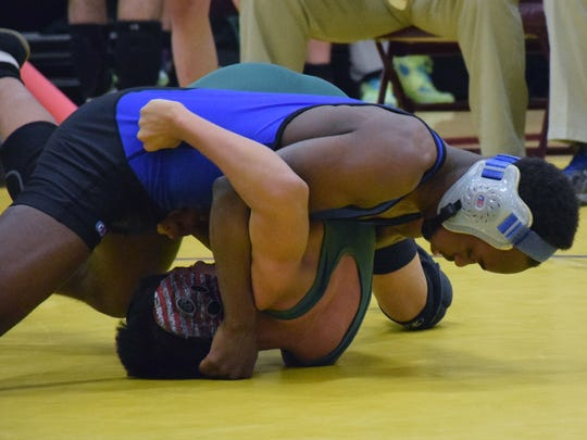 Robert E. Lee's Ta' Strother, top, turns Wilson Memorial's Johnny Lopez during their 113-pound bout at the VHSL Conference 36 wrestling tournament on Saturday, Feb. 4, 2017, at Stuarts Draft High School in Stuarts Draft, Va.