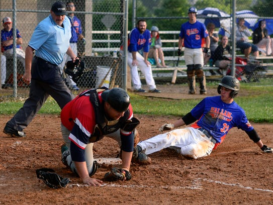 Hallam's Ryan Day slides safely into home as Jacobus