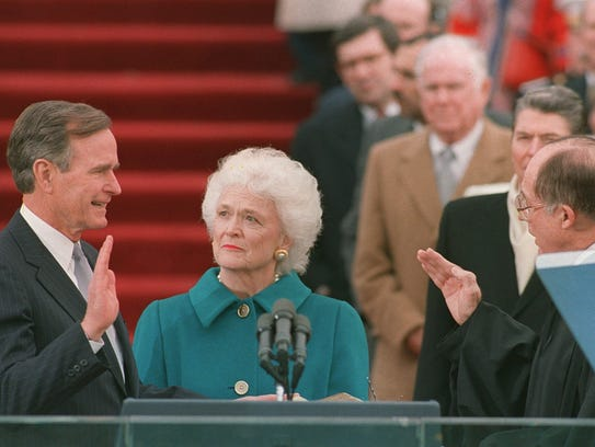 President George H.W. Bush is sworn into office on