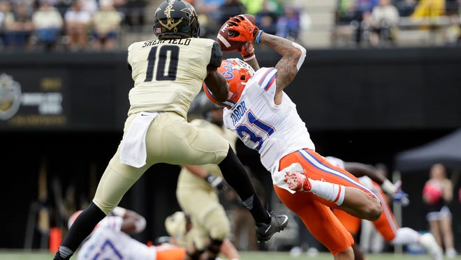 Florida defensive back Teez Tabor (31) intercepts a pass intended for Vanderbilt wide receiver Trent Sherfield (10) on Oct. 1, 2016, in Nashville, Tenn.