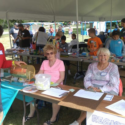 John Church members Donna Polzin, Patty Peck, and Carol Veternick get ready to welcome the community to the Carnival on Sunday, Aug. 21, 2016.