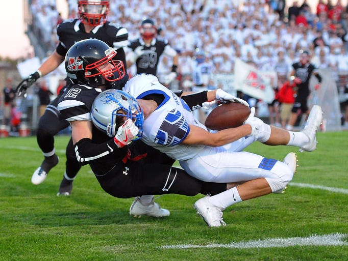 Waukesha West wide receiver Brian Dobrich, right holds