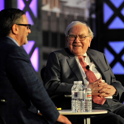 Dan Gilbert talks with Warren Buffett, right, at the Detroit Homecoming conference at College for Creative Studies.