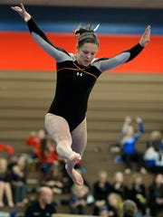 St. Cloud Tech junior Lara Aycock takes flight during