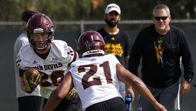 Defensive back Chad Adams (21) guards safety Ty Thomas (26) during a drill. Arizona State held their first football practice on Tuesday, July 25 at the Verde Dickey Dome.