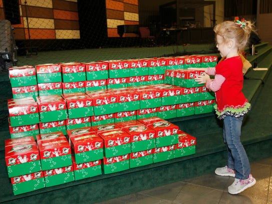Caleigh Peluyera, 4, places an Operation Christmas
