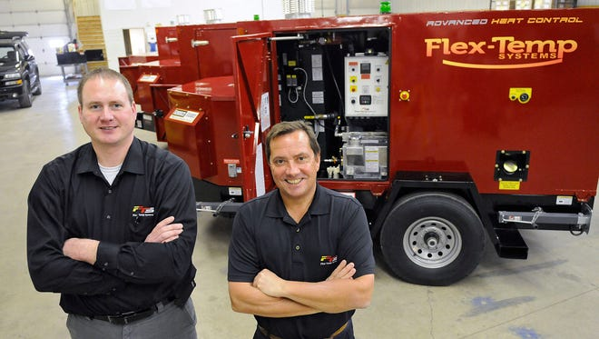 Flex-Temp Systems Vice President Shawn Yurczyk, left, and President Chuck Sanvik stand in the company's production facility March 17 in Waite Park.