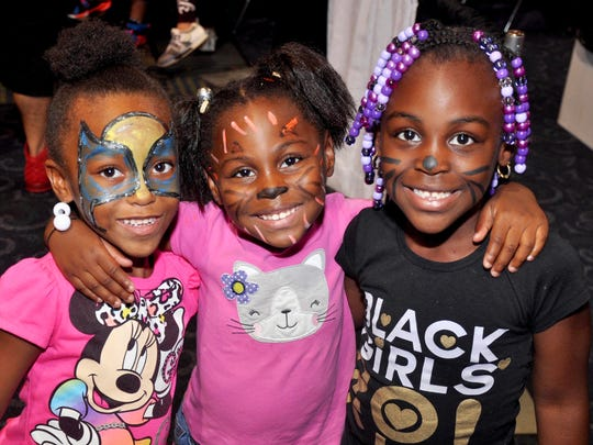 Allanah Drake, Aaliyah William and Aziyah William show off their face paint during the Big Backpack Event at Harborside Event Center. It's an annual back-to-school bash and school supply giveaway sponsored by The Multicultural Centre of SWFL.