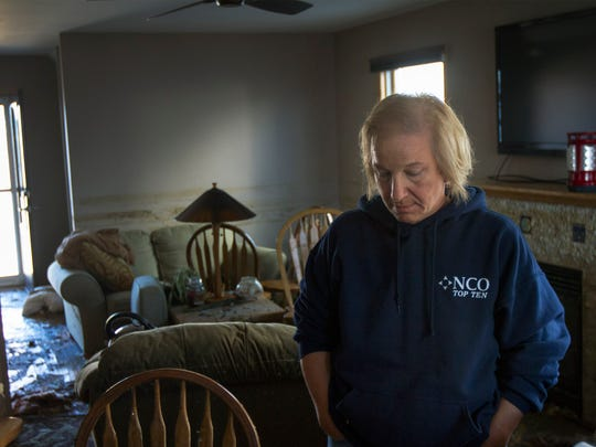 Kathy Barisciano looks over what left of her Ortley Beach livingroom after Superstorm Sandy washed through it.