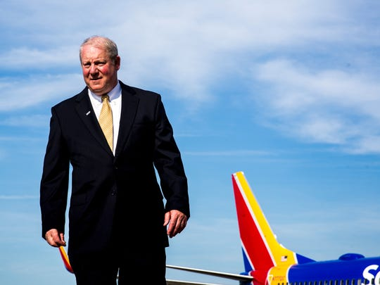 Bobby Spann, vice president of external affairs for CVG, stands in front of the first airplane to take off from Cincinnati/Northern Kentucky International Airport to Chicago Sunday, June 4, 2017.