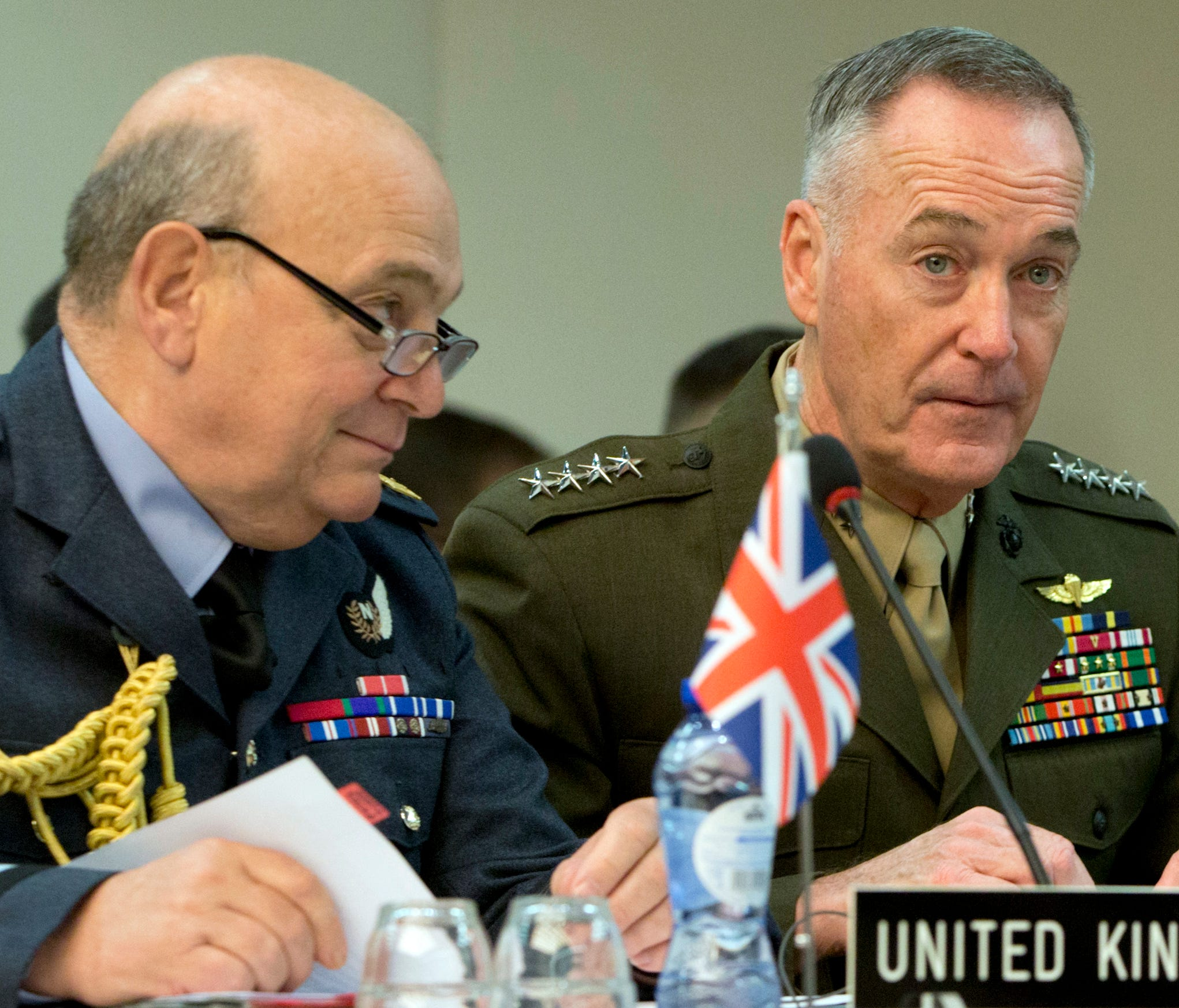 British Chief of Defense Air Chief Marshal Sir Stuart Peach, left, speaks with U.S. Chief of Defense General Joseph F. Dunford, Jr. during a meeting of NATO chiefs of defense at NATO headquarters in Brussels on Wednesday, May 17, 2017. (AP Photo/Virg