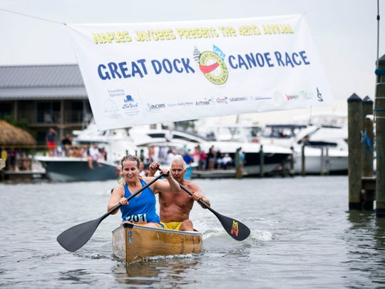 A.J. Ervin and her father, Bill Ervin, cross the finish line in the 'Practically Professionals' race during the 42nd annual Great Dock Canoe Race last year at Crayton Cove.