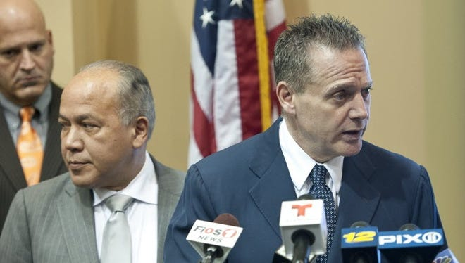 Paterson Police Director Jerry Speziale, right, said Monday that police would increase patrols near the city's mosques.