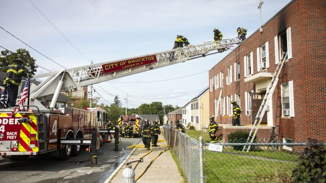 Brockton firefighters responded to a two-alarm fire at 26 St. Casimir Ave., a two-story brick building that was formerly used as a Catholic convent and now used as a sober home, on Monday, Sept. 14, 2020. When firefighters arrived, they found two residents rescuing a man on the second floor from a ladder. Firefighters quickly worked to extinguish the fire in on the right side of the second floor.
