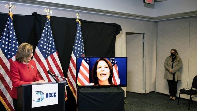 Speaker of the House Nancy Pelosi, D-Calif., talks to reporters about Election Day results in races for the House of Representatives, at Democratic National Committee headquarters in Washington, Tuesday, Nov. 3, 2020. She was joined on a video call by Rep. Cheri Bustos, D-Ill., chairwoman of the Democratic Congressional Campaign Committee.