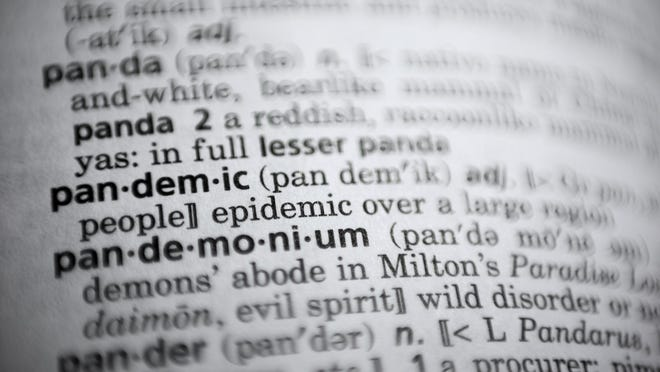 """In this Saturday, Nov. 21, 2020, photo the word pandemic is displayed in a dictionary in Washington. Merriam-Webster on Monday announced """"pandemic†as its 2020 word of the year."""