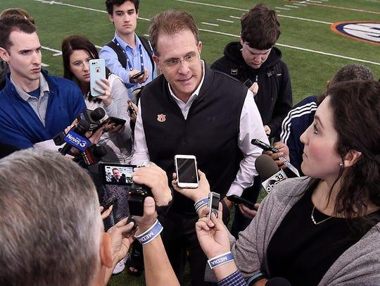 Auburn coach Gus Malzahn talks to the media after Auburn
