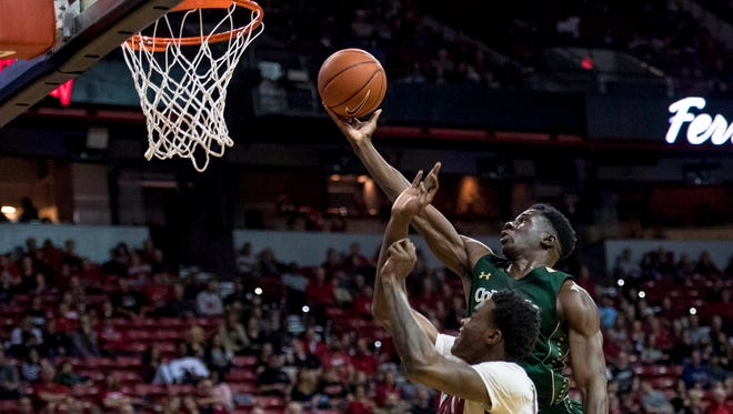 CSU guard Joe De Ciman lays in a shot over UNLV's Dwayne Morgan during a game Saturday night in Las Vegas. The Rebels won 87-80, dropping the Rams to 6-6 in Mountain West play.
