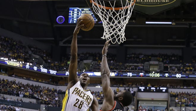 Indiana Pacers center Ian Mahinmi (28) puts up a shot over Toronto Raptors forward Patrick Patterson (54) in the second half of their Eastern Conference first round playoff game Saturday, April 23, 2016, afternoon at Bankers Life Fieldhouse. The Pacers defeated the Raptors100-83.