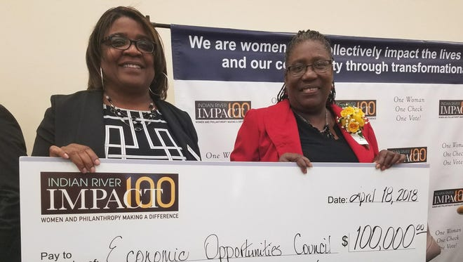 Environmental Opportunities Council Executive Director Angela Davis-Green and Head Start/Early Bird Program Director Natalie Sanders accept a $100,000 grant from Impact 100 Indian River for early childhood education program to open at Dodgertown Elementary.