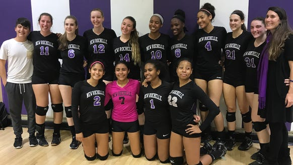 New Rochelle volleyball poses after sweeping North