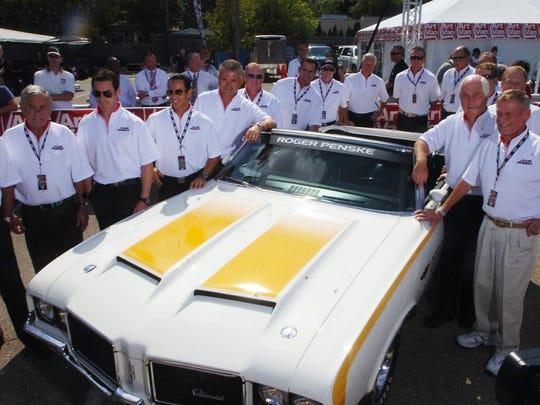 Before the Penske caravan down Woodward Roger Penske gathered the Team Penske for a picture.