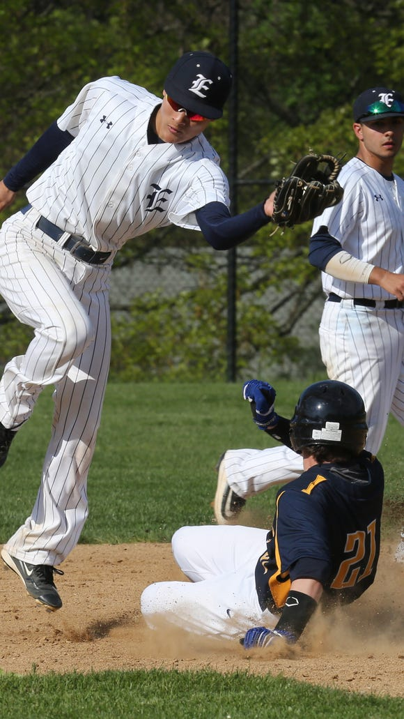Pelham's Gordy MacDonald (21) steals second base over Eastchester's Tak Miki (11) during baseball at Eastchester High School on May 12, 2016.