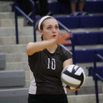 Anna Williams serves for Roger Bacon in a Division III regional semifinal against Sparta Highland Oct. 30, 2014.