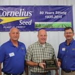 Big Country Seeds, of Tiffin, recently was honored with the Top Soybean Volume Sales award at the annual Cornelius Seed sales meeting hosted near Bellevue. Big Country, operated by Dan Steines, sells Cornelius Seed corn and soybeans as part of its large service lineup that entails several lines of agricultural inputs. The award is given annually to one seed representative in the company's sales and service force. Cornelius Seed is a regional independent seed firm conducting proprietary research, production and sales to eastern Iowa, the northern third of Illinois and southwest Wisconsin. It is one of the largest independent seed companies in the industry. Pictured, from left, are Gary Jackson, district sales manager; Dan Steines, Big Country Seeds and Chuck Cornelius, president of Cornelius Seed.