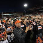 Sep 4, 2015; Corvallis, OR, USA; Oregon State Beavers head coach Gary Andersen (C) celebrates with players after defeating the Weber State Wildcats 26-7 at Reser Stadium. Mandatory Credit: Scott Olmos-USA TODAY Sports
