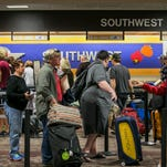 A line of travelers form outside the Southwest ticketing booths on the Sunday before Thanksgiving at Phoenix Sky Harbor International Airport in Phoenix, AZ on Nov. 23, 2014.