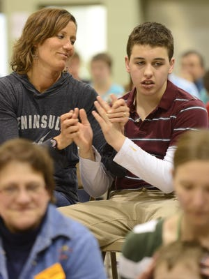 A teacher and student at Syble Hopp School in De Pere clap along during a concert in 2013. The school is for developmentally disabled young people.