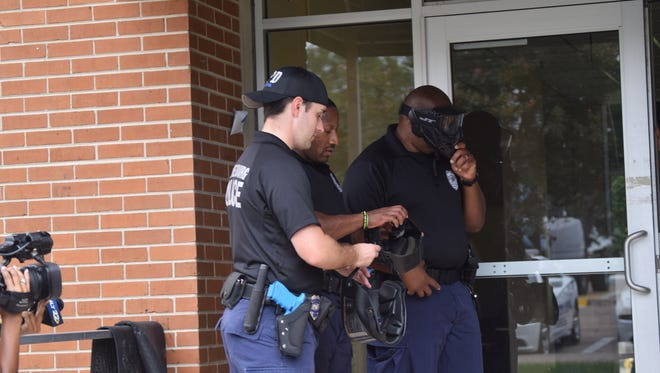 Hattiesburg police officers Demetrius Breland, Erick Mitchum and Thomas Robertson are getting ready for an active-shooter exercise during training Monday at Southern Miss.