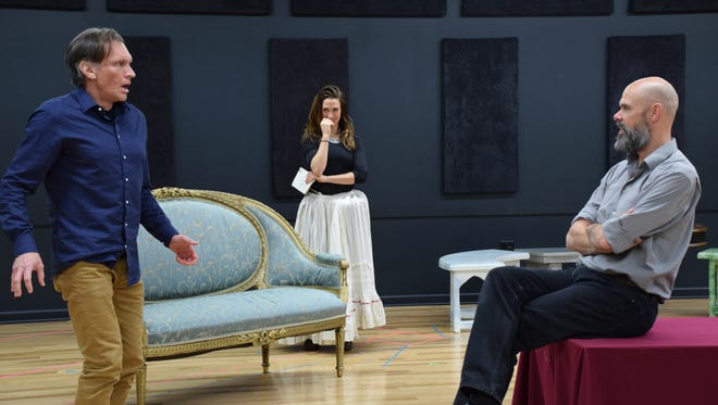 """""""Tartuffe,"""" Moliere's comedy about a religious fraud, kicks off the 2018 season of the Shakespeare Theatre of NJ in Madison. Brent Harris as Tartuffe (left), Caroline Kinsolving as Elmire, and Patrick Toon as Orgon rehearse a scene from the play, which runs through June 3."""