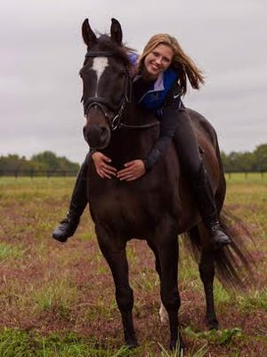 St. Clair alumna Hollis Glowniak pictured with her horse, Savvy.