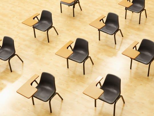 Desks in empty classroom.