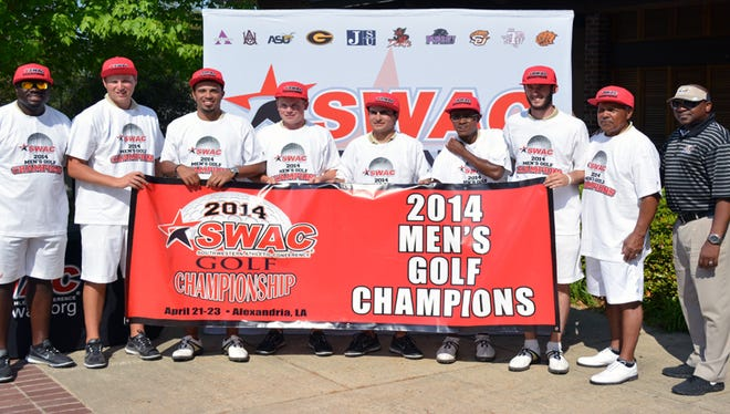 Alabama State men's golf team poses with championship banner after winning the conference tournament on Wednesday.