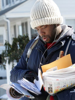 Port Chester letter carrier Malcolm Alexander sorts mail while making deliveries in sub-freezing weather Feb. 13. He stressed the importance of dressing in layers and wears hand warmers under his gloves.