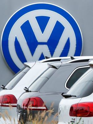 Volkswagen is expected to plead guilty on Friday to fraud in federal court. This photo, taken on Sept. 29, 2015, shows the logo of German car maker Volkswagen at Northern Virginia dealer in Woodbridge, Virginia.
