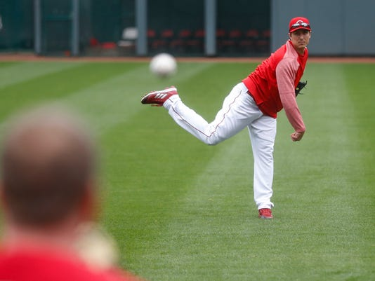 Cincinnati Reds starting pitcher Homer Bailey works out at Great American Ballpark, Thursday, March 29, 2018, in Cincinnati. Their first game of the regular season against the Washington Nationals was postponed until Friday due to weather. (AP Photo/John Minchillo)
