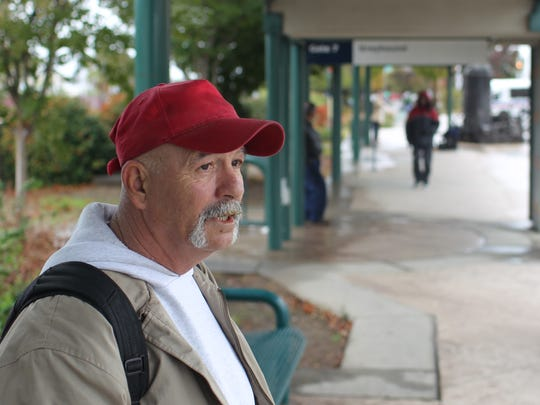 Steven Mooney waits Wednesday for the arrival of a Greyhound bus to take him to Reno.