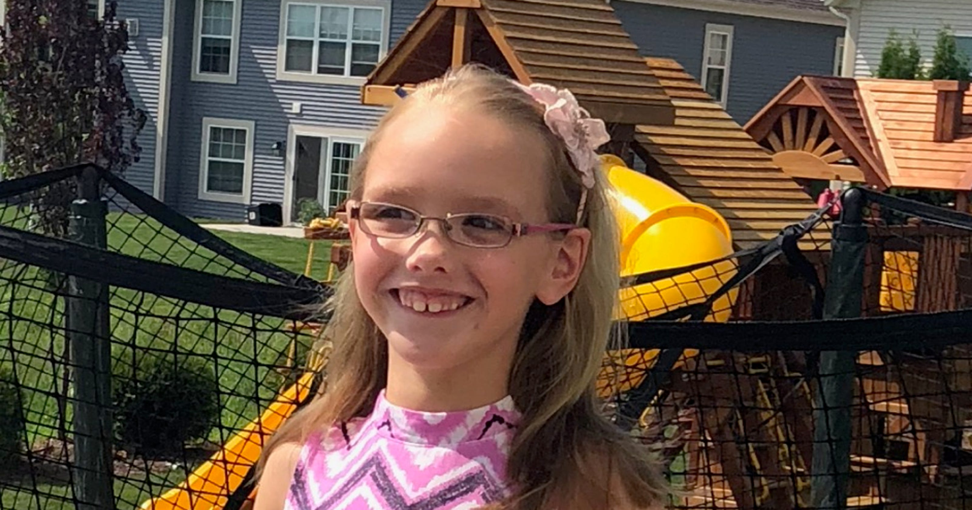 Girl fights infection while legal battle brews over her swing set