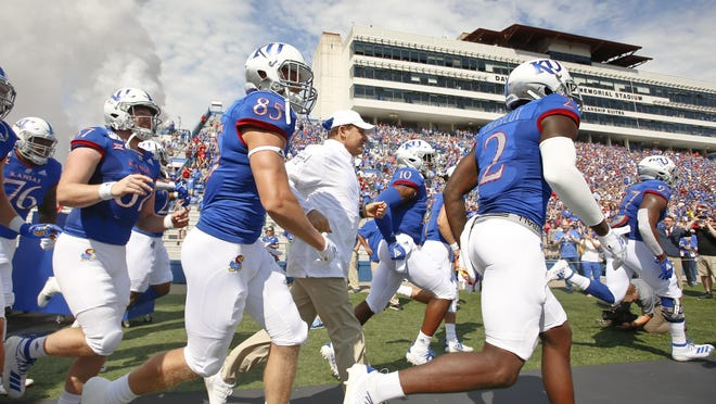 The Kansas football team on Saturday confirmed one of its athletes has tested positive for COVID-19 and another has tested positive for COVID-19 antibodies.