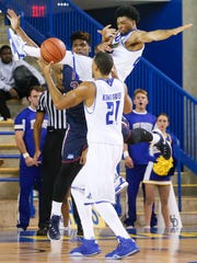 Delaware guard Cazmon Hayes is fouled as he drives against Fairleigh Dickinson's Mike Holloway (rear) in front of forward Marvin King-Davis in the second half of the Blue Hens' 73-72 win at the Bob Carpenter Center Tuesday.